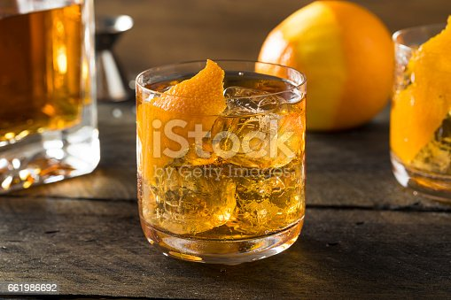 istock Boozy Homemade Old Fashioned Bourbon on the Rocks 661986692