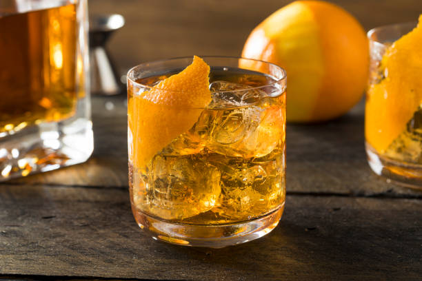 Boozy Homemade Old Fashioned Bourbon on the Rocks stock photo