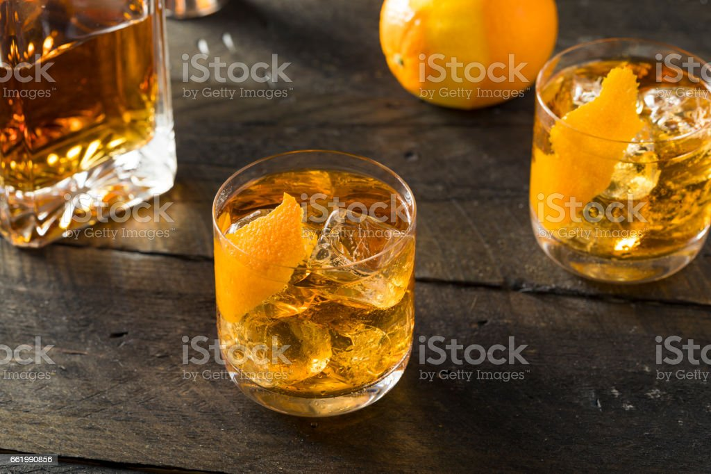 Boozy Homemade Old Fashioned Bourbon on the Rocks royalty-free stock photo