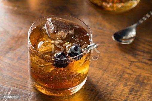 Boozy Manhattan Cocktail on the Rocks with a Cherry Garnish