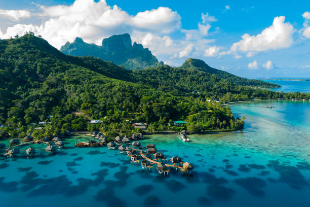 Bora Bora aerial drone image of travel vacation paradise and overwater bungalows stock photo