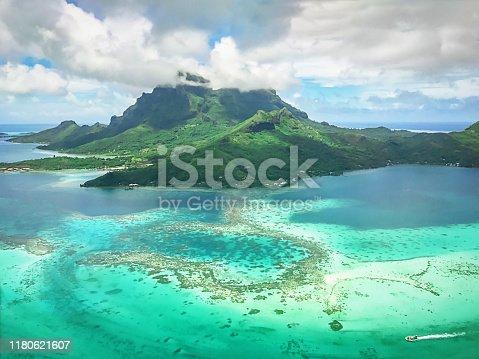 Beautiful Bora Bora Island Aerial View over the pristine turquoise lagoon towards the volcanic Mount Otemanu. Bora Bora, Society Islands, French Polynesia.