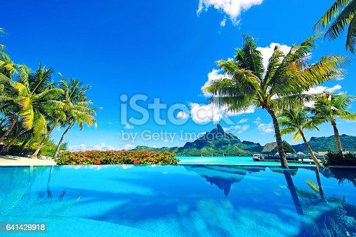 Beautiful infinity pool, Mt Otemanu and flowers in Tahiti.