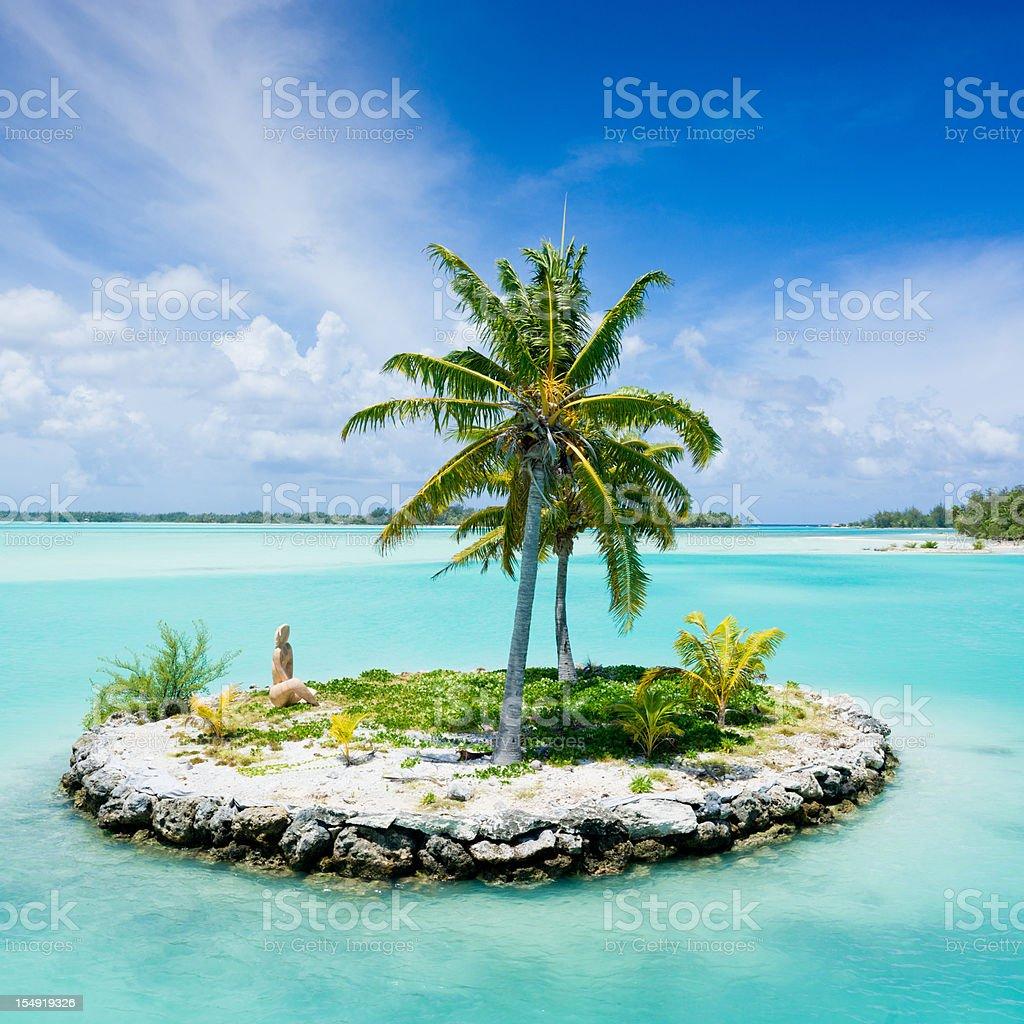 Bora-Bora Island Airport Lagoon Islet Tiki Statue stock photo