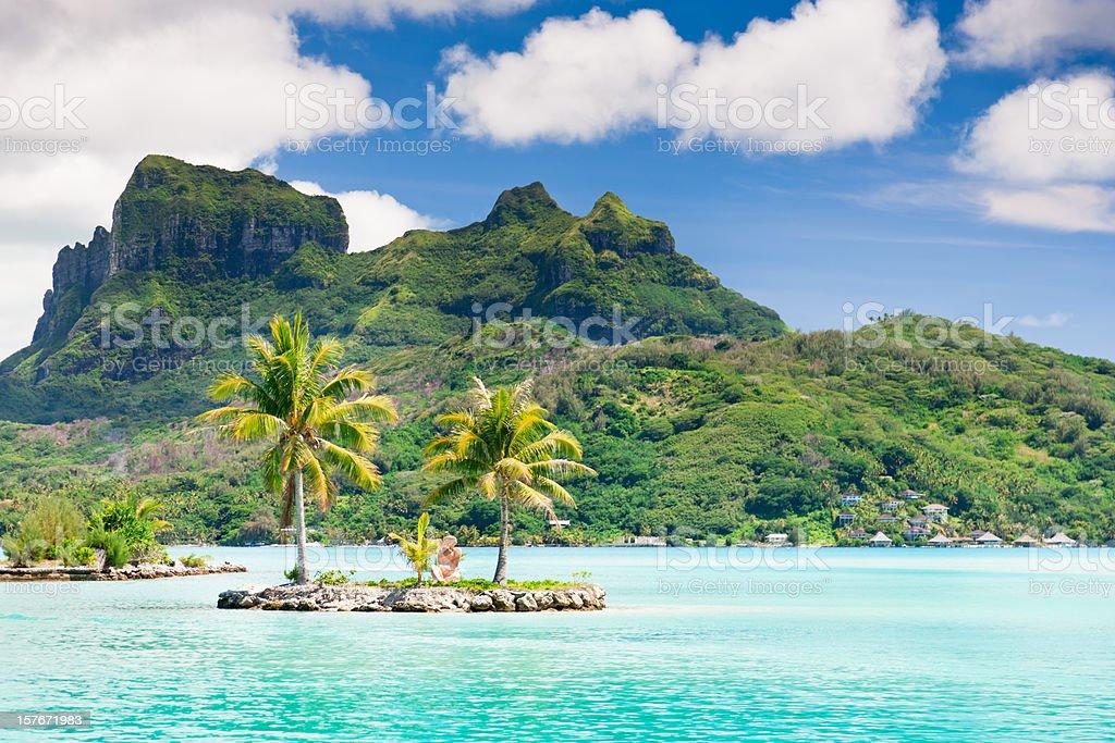 Bora-Bora Island Airport Lagoon Tiki Statue Islet stock photo