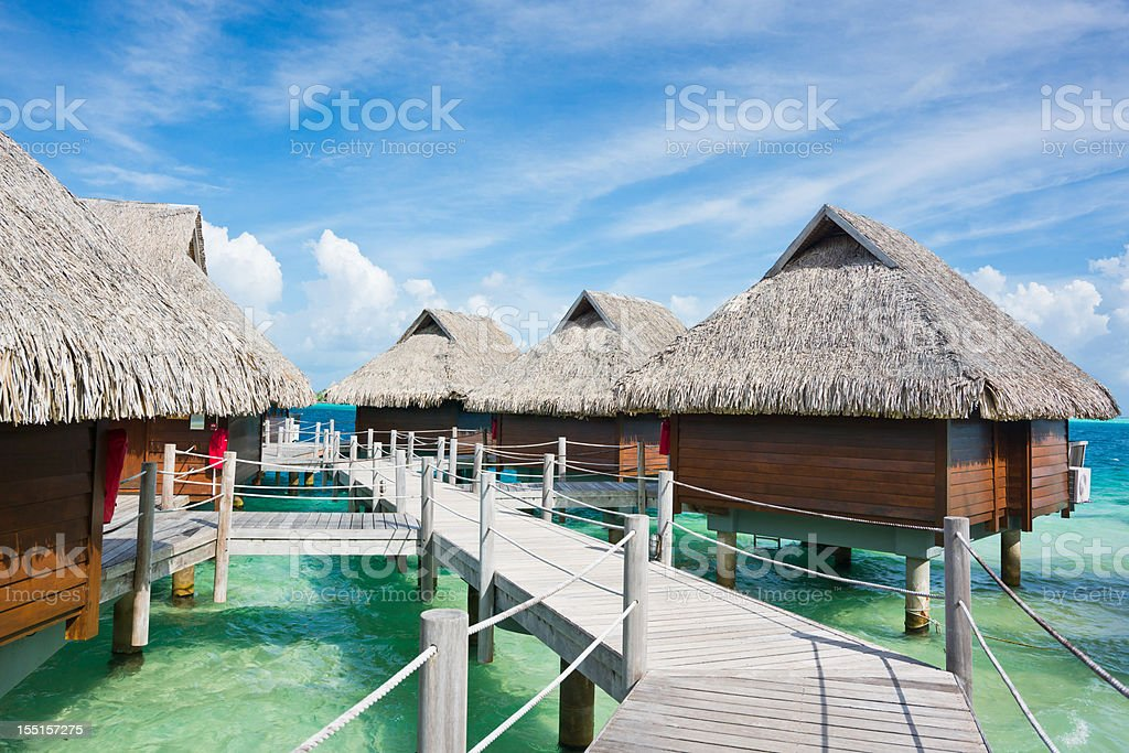 Bora-Bora Island Stilt Huts Luxury Tourist Resort royalty-free stock photo