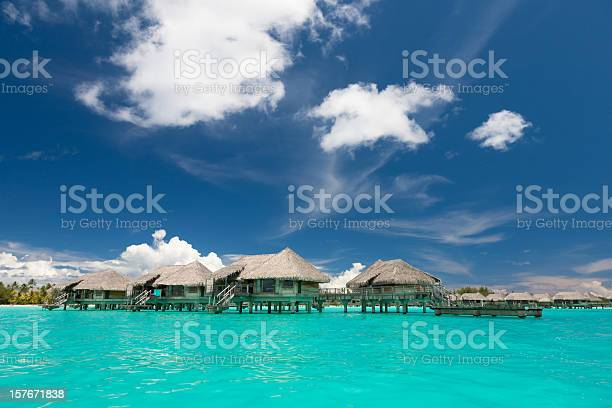 Borabora Lagoon Stilt Houses Stock Photo - Download Image Now