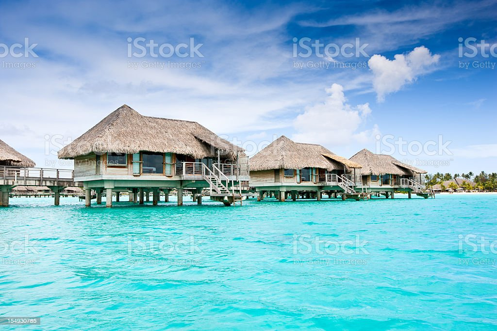 Bora-Bora Tourist Resort Lagoon Stil Huts stock photo