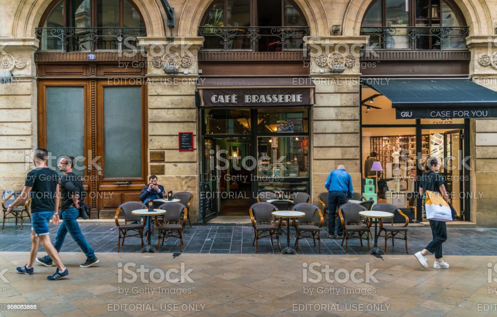 Bordeaux, France, 8 may 2018 -tourists and locals passing a Cafe Brasserie at the main shopping street 'Rue Sainte-Catherine' stock photo