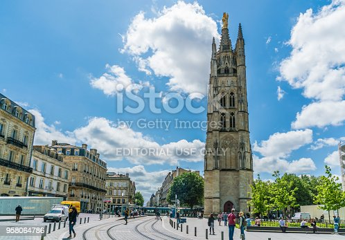 Bordeaux, France, 9 may 2018 - Locals and tourists passing the Tour Pey Berland next to the Famous Cathédrale Saint-André de Bordeaux