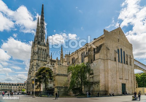Bordeaux, France, 9 may 2018 - tourist passing the Famous Cathédrale Saint-André de Bordeaux