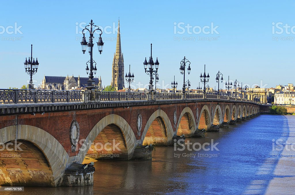 Bordeaux river bridge with St Michel cathedral in background royalty-free stock photo