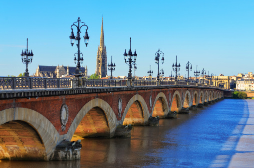 Bordeaux river bridge with St Michel cathedral in background, France