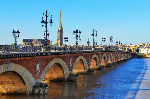 Bordeaux river bridge with St Michel cathedral in background stock photo