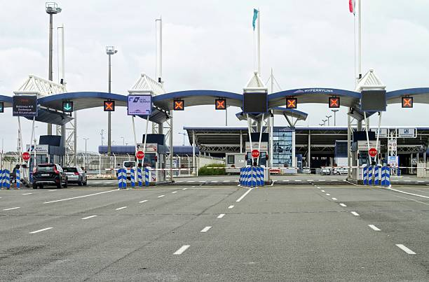 border control at port of Calais , France Calais, France - July 27, 2015: a few cars at border control at port of Calais , France customs official stock pictures, royalty-free photos & images