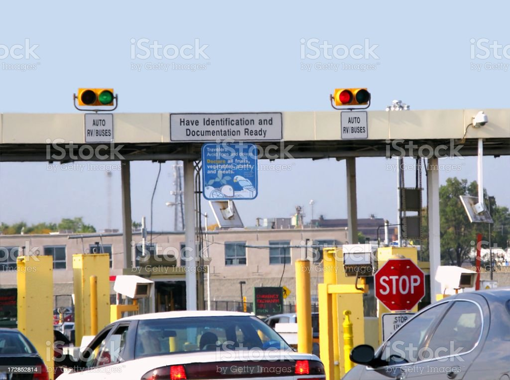 Border crossing with cars waiting to cross stock photo