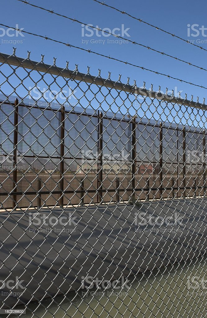 US Border Fence and Barbed wire royalty-free stock photo