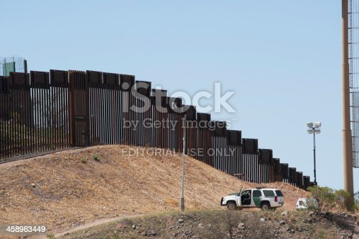 Nogales, United States - March 26, 2012:  Since this section of new 18 foot tall fence has been completed in 2011, officials have cut the number of aliens entering the United States at this particular location drastically.  However, only 685 miles of the 2,100 miles of common border between Mexico and the US have been fenced, and much of that fence is useless barbed wire or chain link.  One mile of this new fencing costs from $1 million to $3 million dollars, and Arizona is using prison labor to cut down on costs. Fences will not totally deter illegal immigration - Nogales, for instance, is reputed to have more underground tunnels for smuggling people and drugs in the US than any other location along the border.