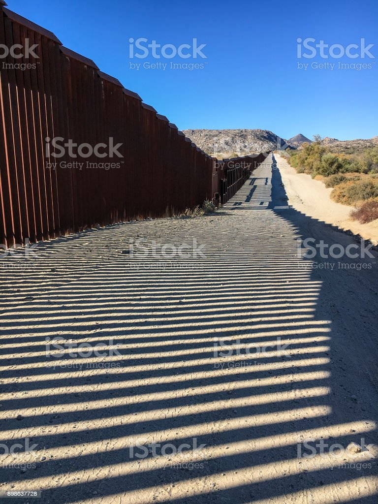 Border fence and shadow stock photo
