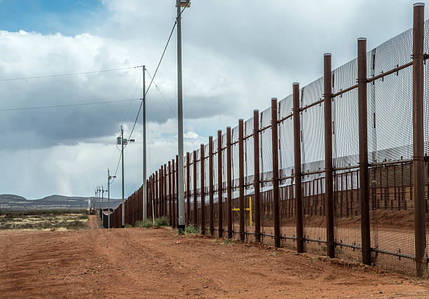 Border fence at Naco Arizona Fence at Mexico United States border in Naco Arizona international border barrier stock pictures, royalty-free photos & images