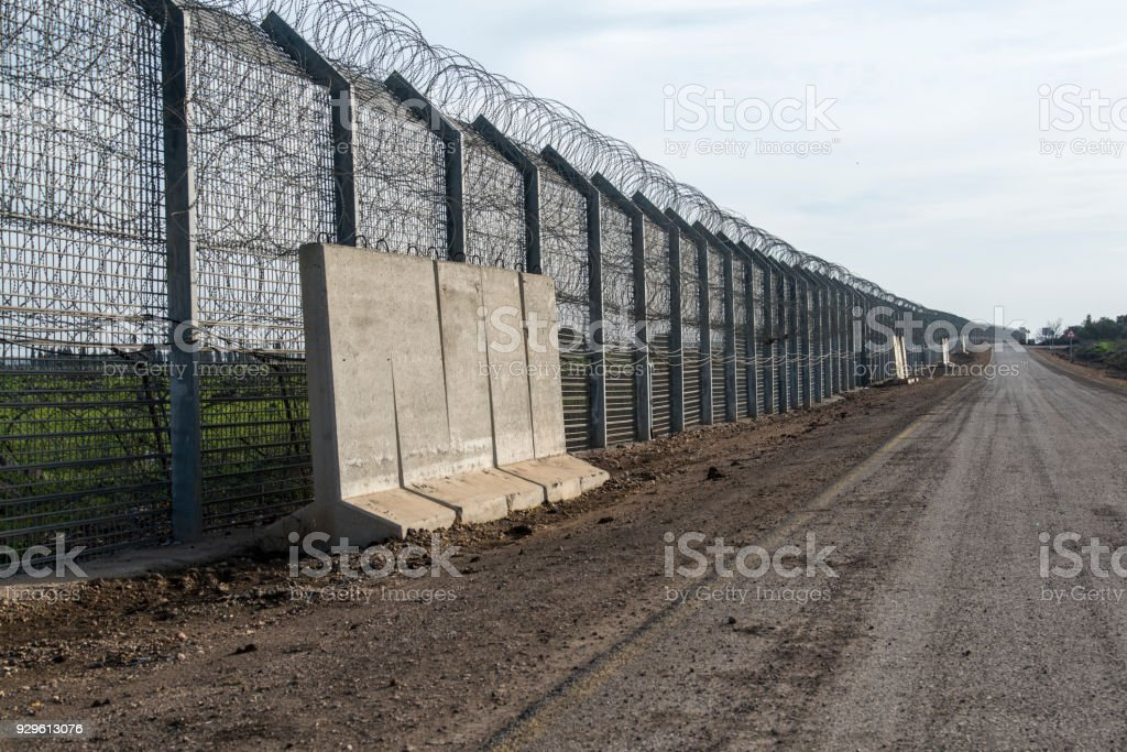 Border fence between Israel and Syria stock photo