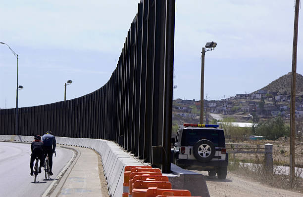 Border Fence Both sides  international border barrier stock pictures, royalty-free photos & images