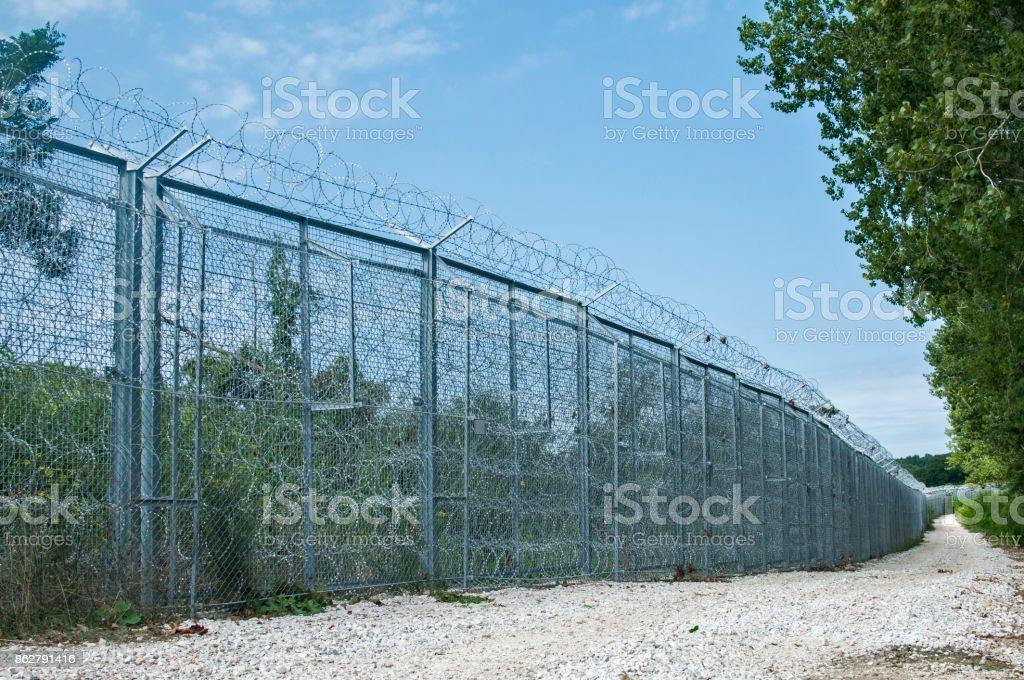 Border fence closeup stock photo