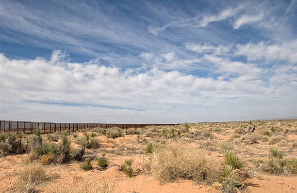 Border Fence in the Desert  international border barrier stock pictures, royalty-free photos & images