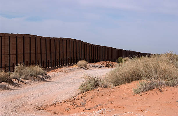 Border Fence - New Mexico  international border barrier stock pictures, royalty-free photos & images