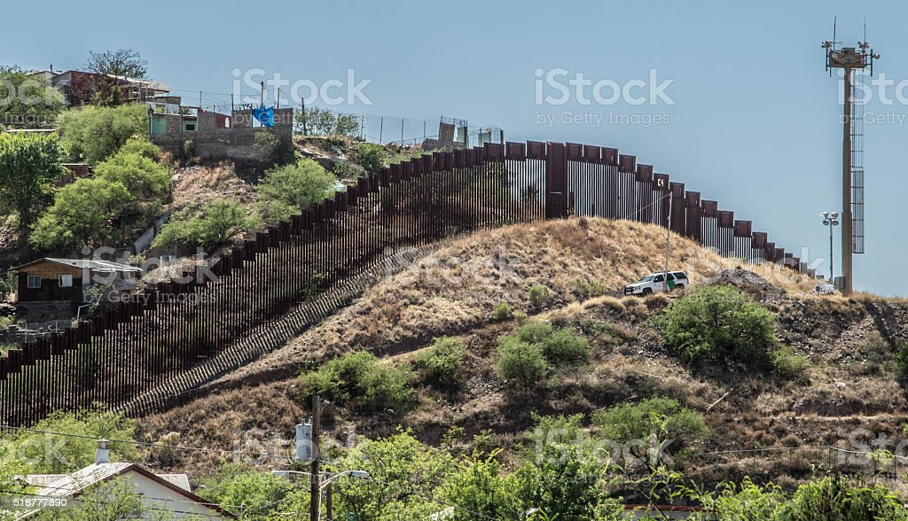 Border fence separating Mexico and the United States stock photo