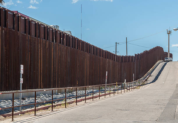 Border fence separating Mexico and the United States Border fence in Nogales Arizona separating the United States from Nogales Sonora Mexico international border barrier stock pictures, royalty-free photos & images