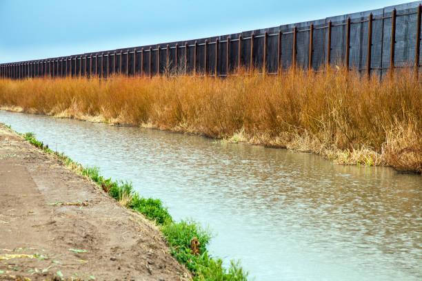 US border fence to Mexico at El Paso stock photo