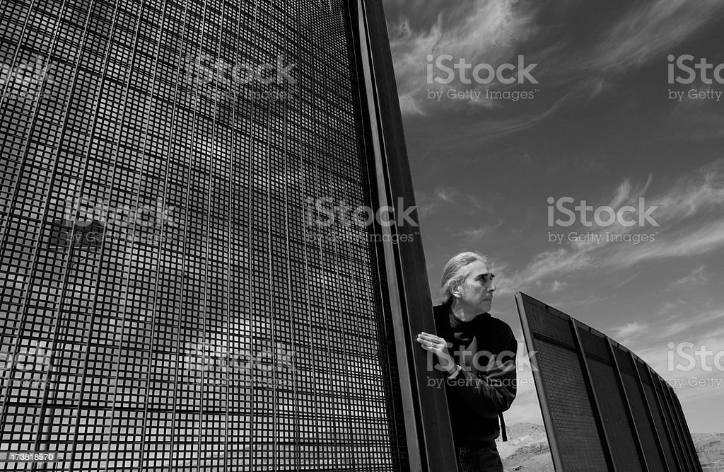 Border Fence with Mexican Male royalty-free stock photo