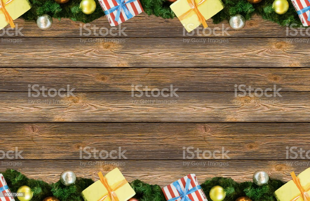 border frame spruce branch furry christmas ball yellow silver and festive boxes base background board with copy space. Christmas New Year Design stock photo