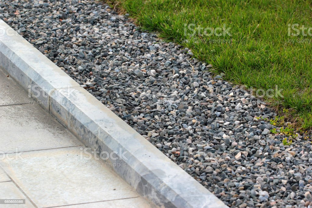 Border kerb between lawn and sidewalk in a park stock photo