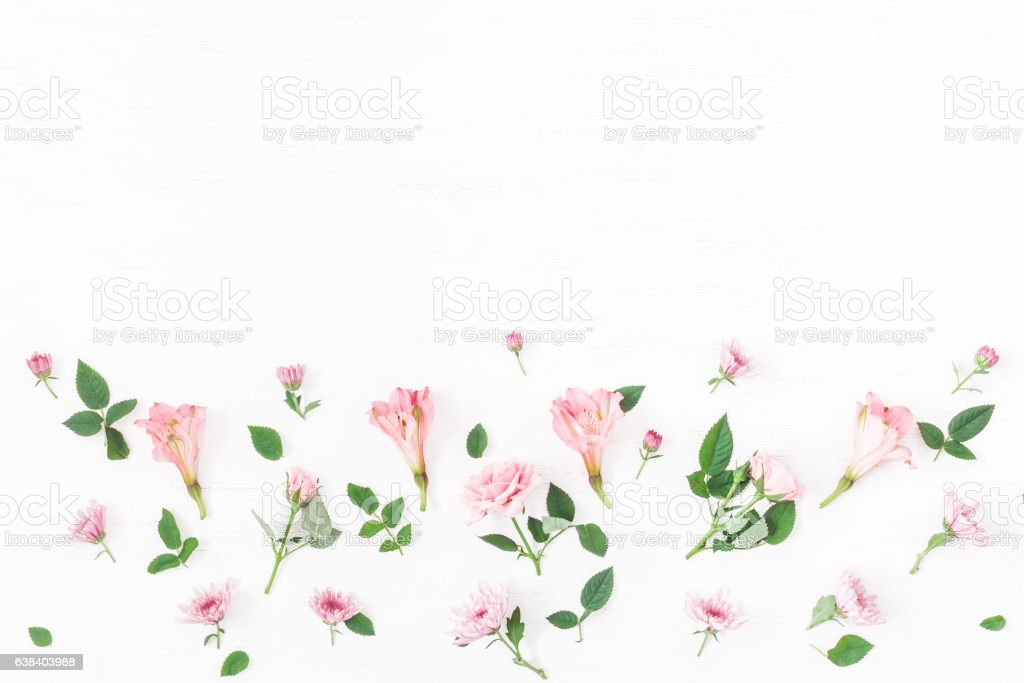 Border made of pink flowers on white background. Flat lay stock photo