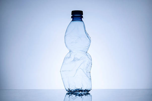 Border of a crumpled empty clear plastic bottle stock photo