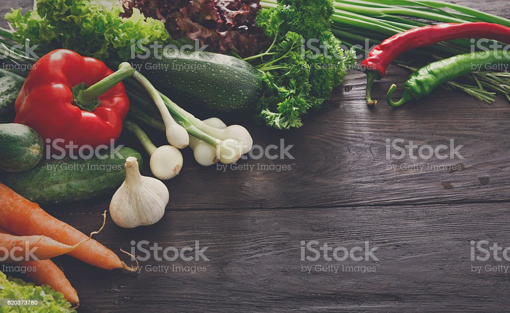Border of fresh vegetables on wooden background with copy space zbiór zdjęć royalty-free