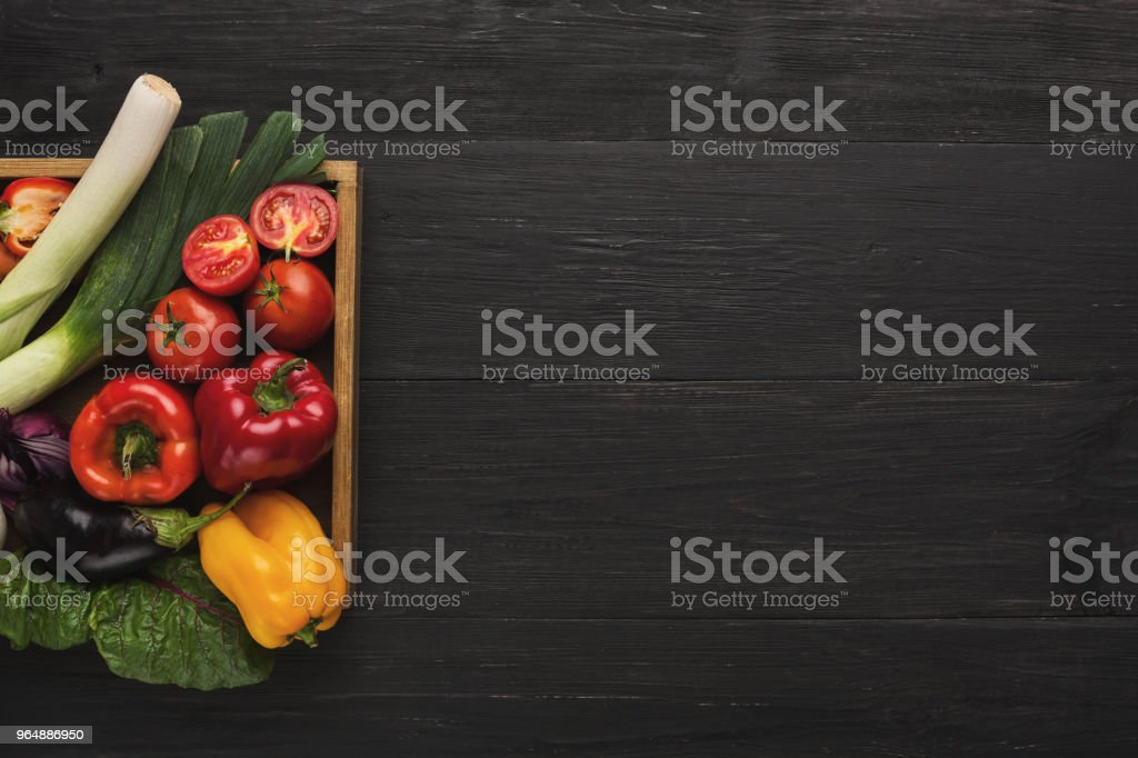 Border of fresh vegetables on wooden background with copy space royalty-free stock photo