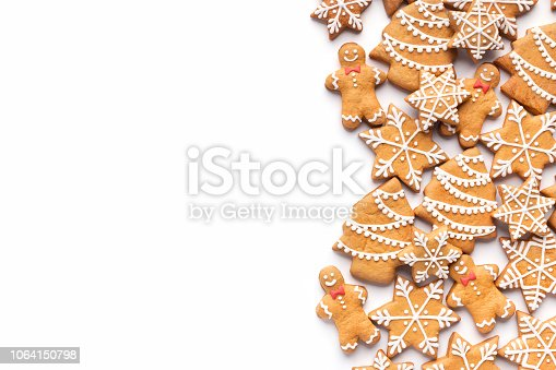 Border of homemade christmas gingerbread cookies on white background with copy space for text