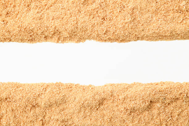 Border of sawdust on white background stock photo