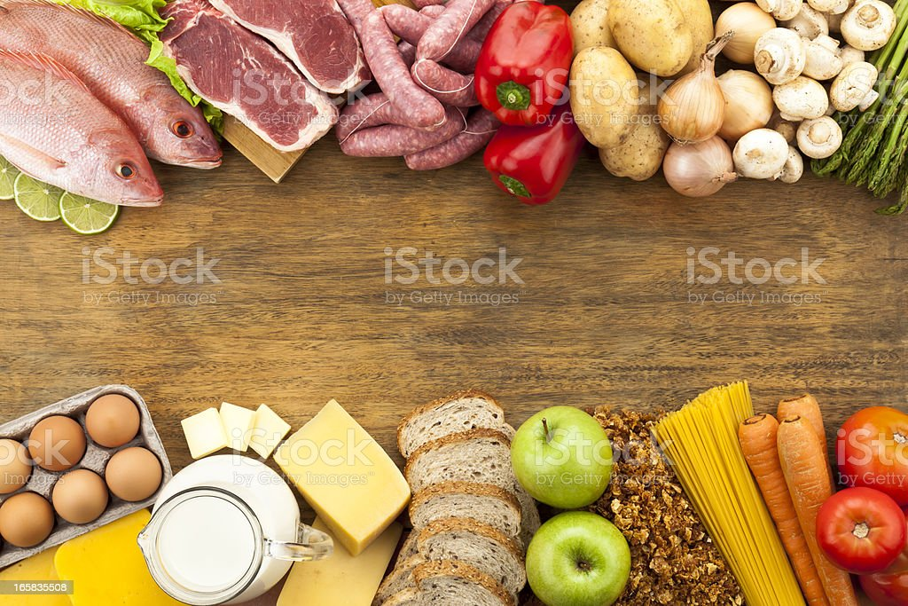 Border of various types of food arranged in two stripes stock photo
