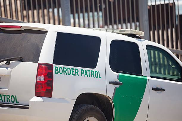 Border Partol at the US Mexico border in San Diego Border patrol car at the US border with Mexico in San Diego with the fence behind. border patrol stock pictures, royalty-free photos & images