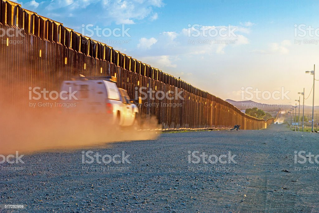 Border patrol trucks driving to catch illegal alien stock photo