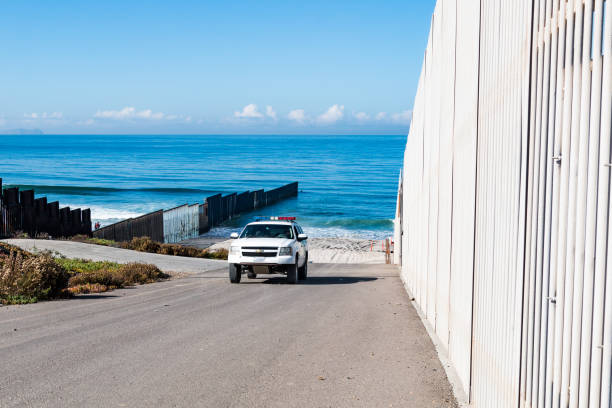 Border Patrol Vehicle Patrols Between Inner and Outer Border Walls in San Diego stock photo