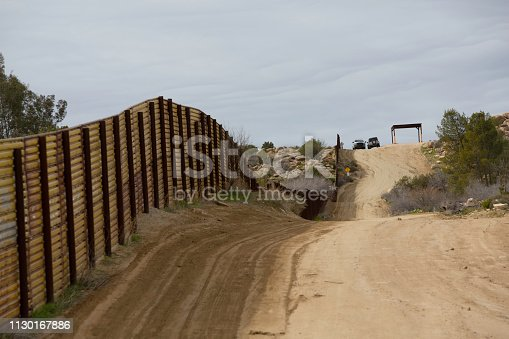 Border Patrol Vehicles near wall  seperating the United States from Mexico