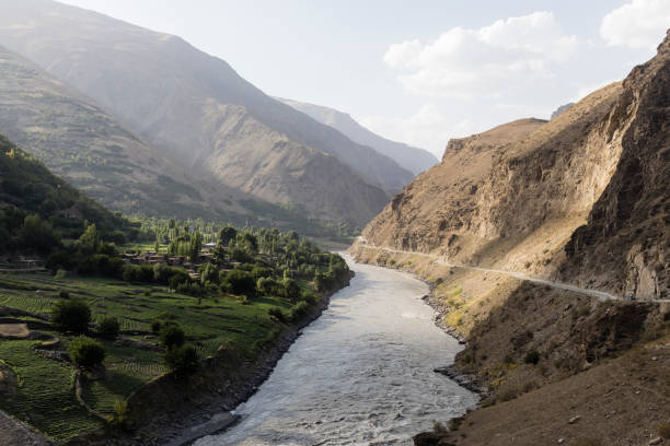 Border river Panj River in Wakhan valley with Tajikistan right and Afghanistan left Border river Panj River in Wakhan valley with Tajikistan right and Afghanistan left Afghanistan stock pictures, royalty-free photos & images