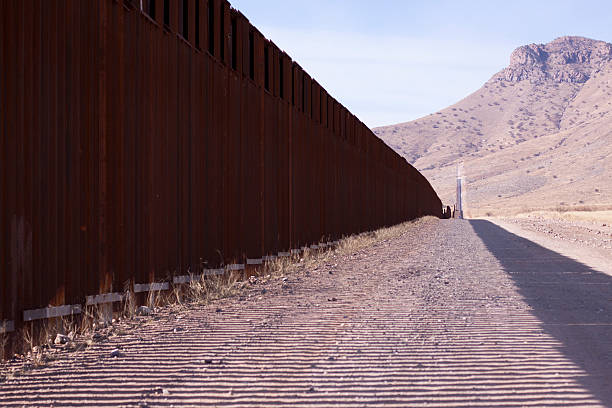 border security 8 Image of the fence separating the Mexican and American border.  Taken in Southern Arizona. border patrol stock pictures, royalty-free photos & images