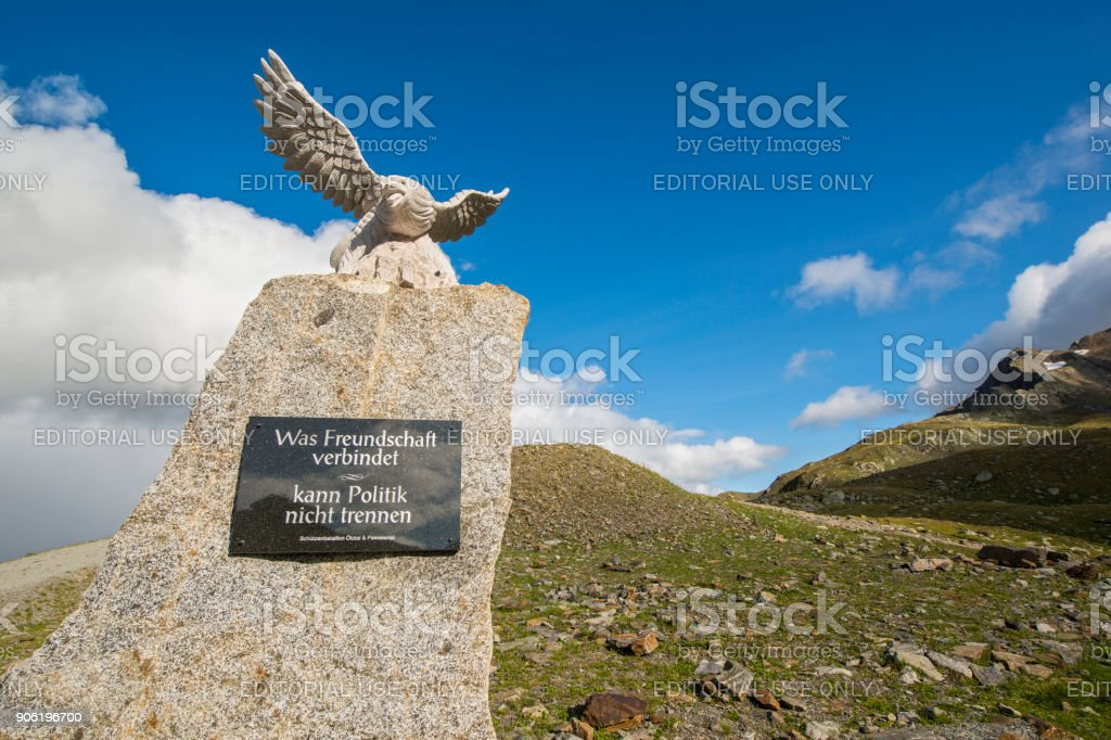 Border sign at the Timmelsjoch between Austria and Italy stock photo