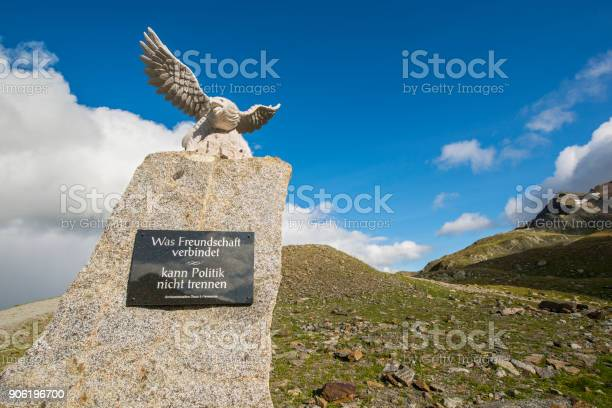 Timmelsjoch, Austria - August 8, 2014: Small monument with an eagle at the border between Austrian and Italy at the Timmelsjoch (Italian: Passo del Rombo), with an elevation of 2,474 metres (8,117 ft)  the highest passroad in the Eastern Alps. The pass is used since the early Stone Age and is still an important link through the Oetztal Alps along the border between Austria and Italy.